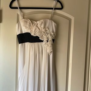 Long ivory dress with spaghetti straps and flowers